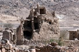 Destroyed houses in the mountainous area of Arhab, north of Sanaa, Yemen